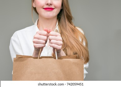 woman, holding, a package, with the purchase, background, with copy space, for advertising