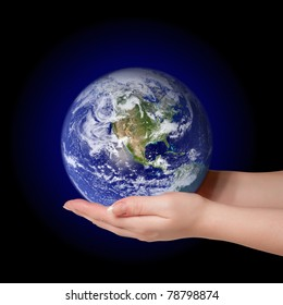 Woman holding in palms earth globe