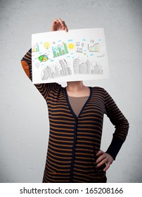 Woman holding a paper in front of her head with charts and cityscape drawing