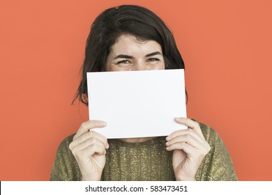 Woman holding paper hiding her lips