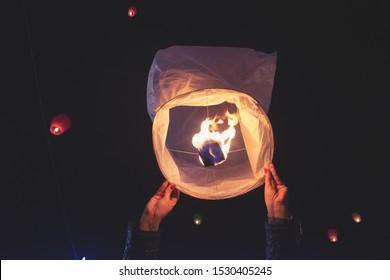 Woman holding a paper lantern