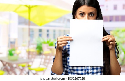 Woman Holding Paper, outdoor