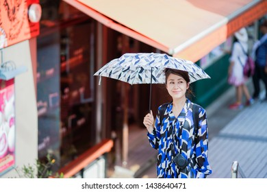 Woman holding a parasol in the city