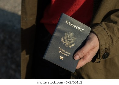 Woman holding a passport in hand ready for travel