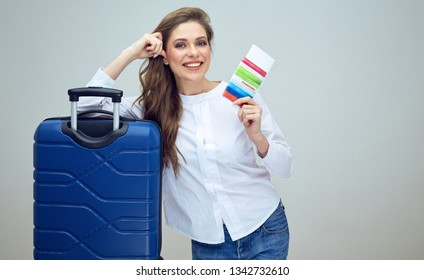 woman holding passport with ticket for vacation travel. isolated studio portrait.