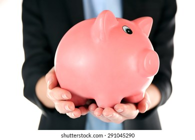 Woman holding piggy bank close up