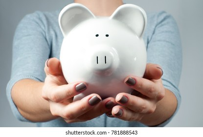 Woman holding piggy bank. Financial budget savings, smart investment concept