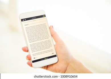Woman holding a pink gold generic smartphone showing ebook