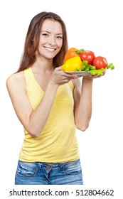 woman holding plate of fresh vegetables