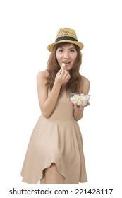 woman holding a pop corn bowl