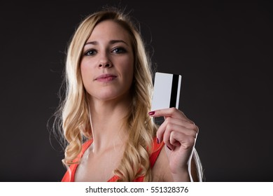 woman holding a powerful weapon: a credit card. is it hers or yours? let's find out