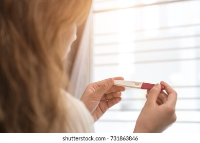 Woman holding pregnancy test, New life and new family concept.