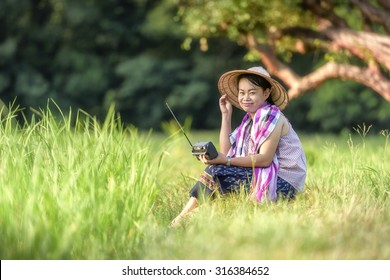 Woman Holding Radio in rice field, Woman country style
