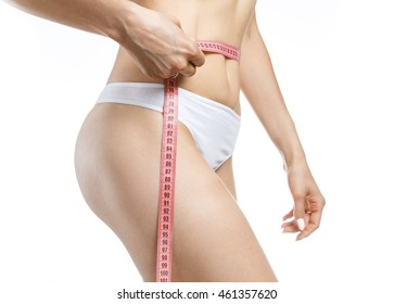 Woman holding red meter measuring perfect shape of her beautiful body, on a white background