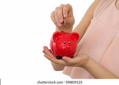woman holding red piggy bank on white background