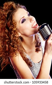 woman holding a retro microphone