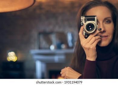 Woman holding retro styled camera