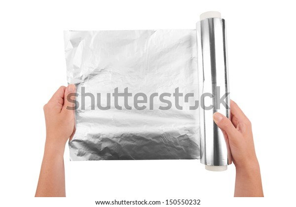 woman holding a roll of aluminum foil