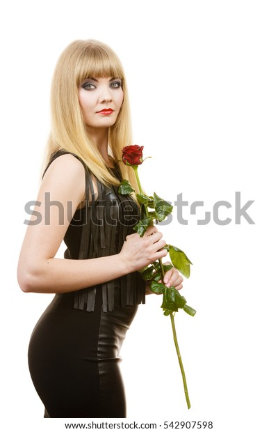 Woman holding rose flower. Attractive blonde lady dark makeup evening black dress studio shot isolated on white. Beauty, dating, celebration concept