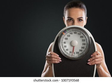 Woman holding a scales