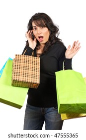 A woman holding several shopping bags, isolated on white background