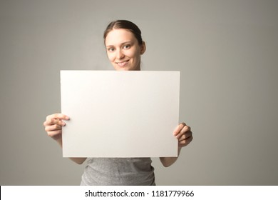 woman holding a sheet of paper in her hand