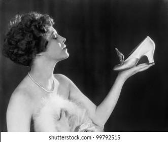 Woman holding shoe