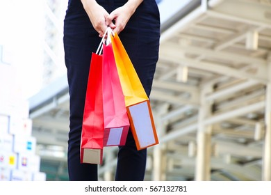 Woman is holding shopping bag