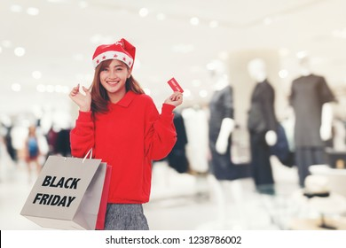 Woman Holding Shopping bag on shopping mall background. black Friday Sale