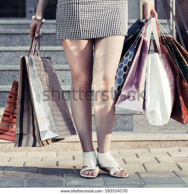 Woman holding a shopping bags