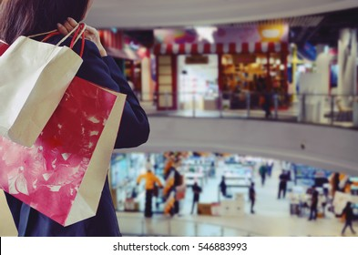 Woman holding shopping bags in the shopping mall