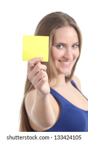 Woman holding and showing a blank yellow paper note on a white isolated background