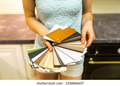 Woman holding and showing colorful texture pattern and color palette - Swatches to choose from