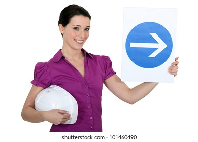 Woman holding sign of obligation to turn right