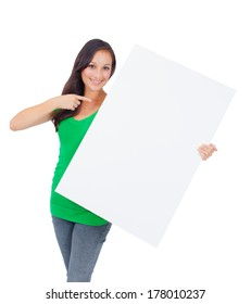 Woman holding signboard billboard smiling fresh. Beautiful playful casual Caucasian woman showing blank sign. Isolated on white background.