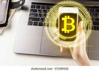 Woman holding smartphone with Bitcoin Technology