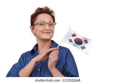 Woman holding South Korea flag. Nice portrait of middle aged lady 40 50 years old with a national flag of South Korea isolated on white background. Learning Korean language. Visit South Korea concept.