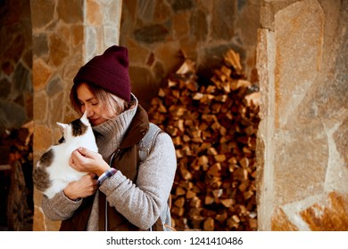 Woman holding stray cat. Volunteerism and adoption concept.