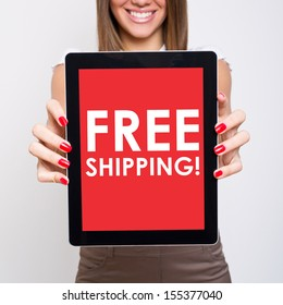 Woman holding tablet computer with free shipping message