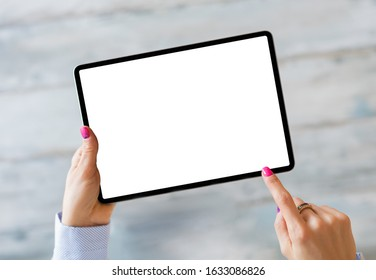 Woman holding tablet with empty white screen