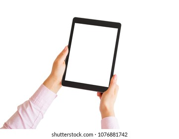 Woman holding tablet vertically in hands with empty white screen.