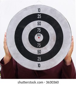 Woman holding a target for you to aim at