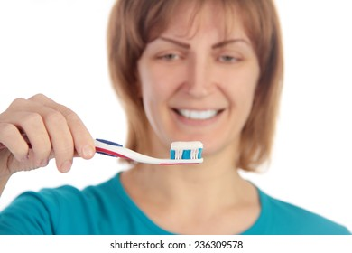 woman holding tooth brush isolated on white background