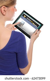 woman holding a touchpad pc, one finger touches the screen and surfing the web