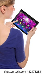 woman holding a touchpad pc, one finger touches the screen playing a retro arcade game