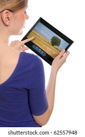 woman holding a touchpad pc showing a movie, isolated on white