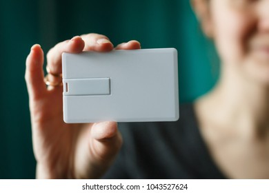 woman holding usb flash bussines card template mock up,