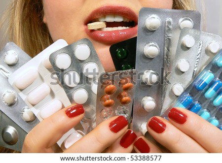 Woman holding various pills