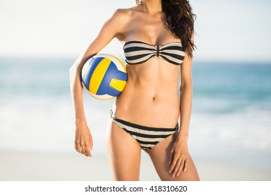 Woman holding volley ball on a sunny day
