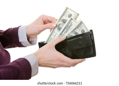Woman holding wallet full of money